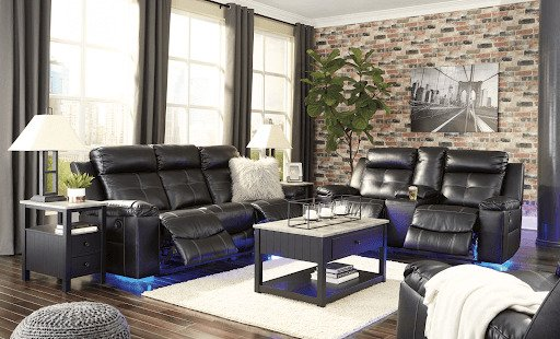 black recliner and loveseat with LED lights in bright living room