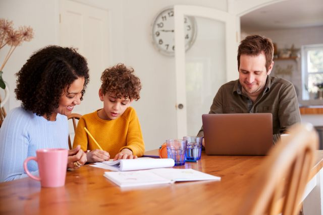 family working from home and homeschooling