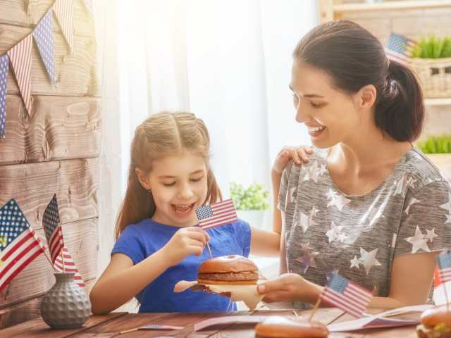 Mother and daughter making patriotic foods