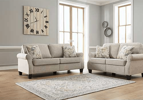 Living room with an Alessio Beige Sofa and Loveseat