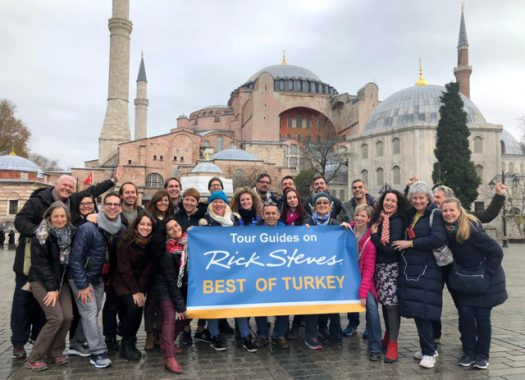 """group of tour guides in instanbul holding up a sign that says """"Tour Guides on Rick Steves Best of Turkey"""""""