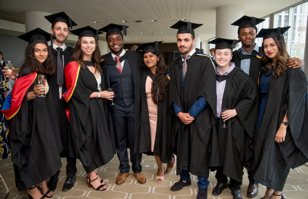 Roehampton graduates pose with champagne glasses