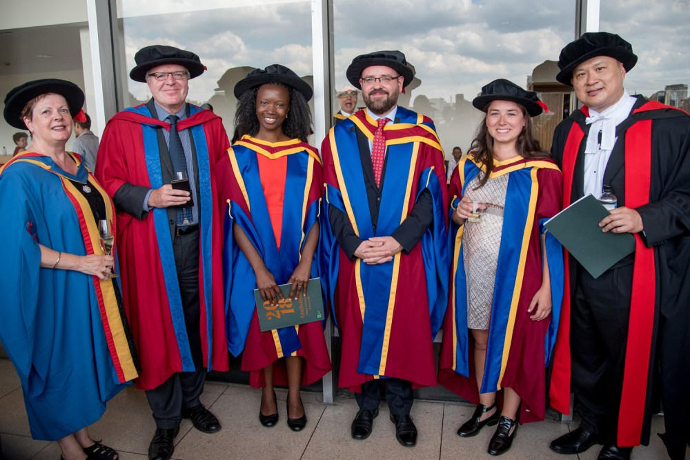 Doctoral graduates, glamming it up, as usual