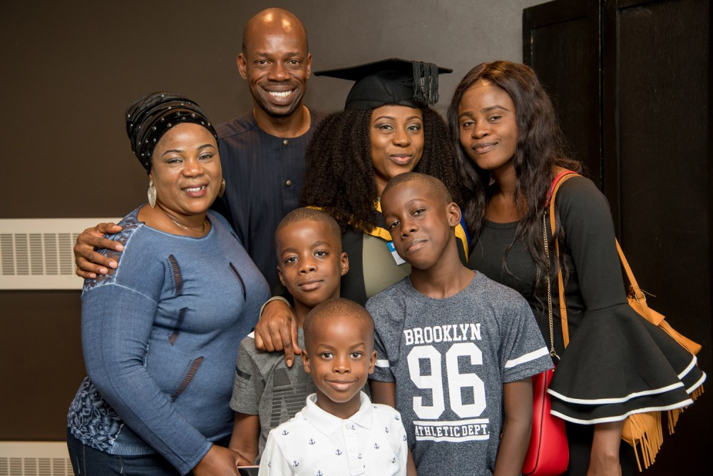 A proud graduate poses with her family