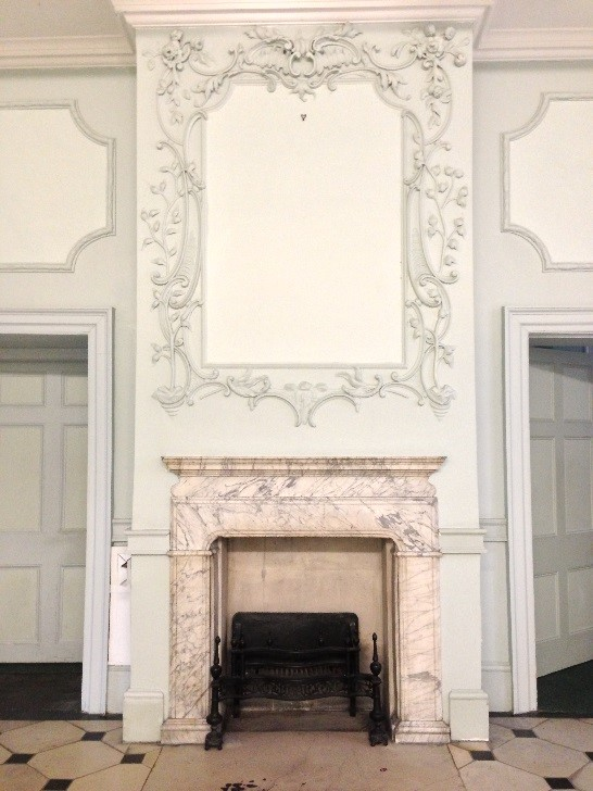 A fireplace in Downshire House
