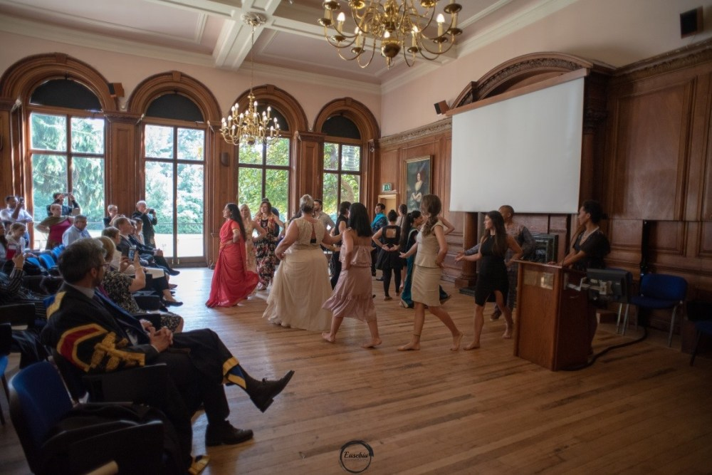 People dancing in the Portrait Room, Grove House