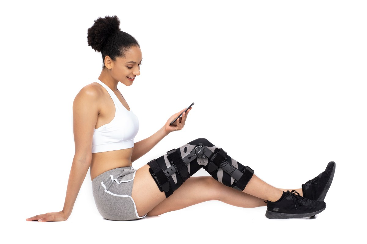Physical therapy patient looking at their ROMBOT app.