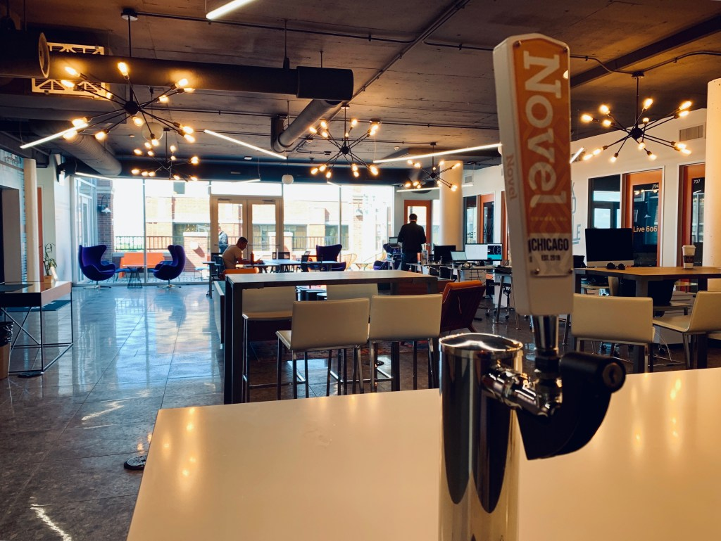 The common spaces at Roompact Offices with beer always on tap