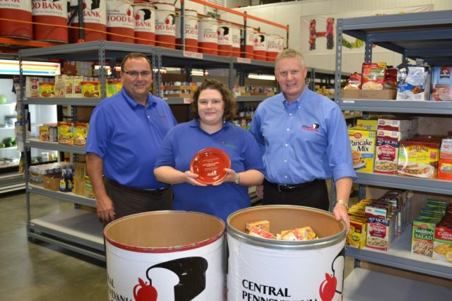 From left, Greg Royer, CEO, Royer's Flowers & Gifts; Jackie Dahms, manager, Royer's West York store; Joe Arthur, executive director, Central Pennsylvania Food Bank. The West York store was recognized for collecting the most pounds of food among Royer's 17 locations.