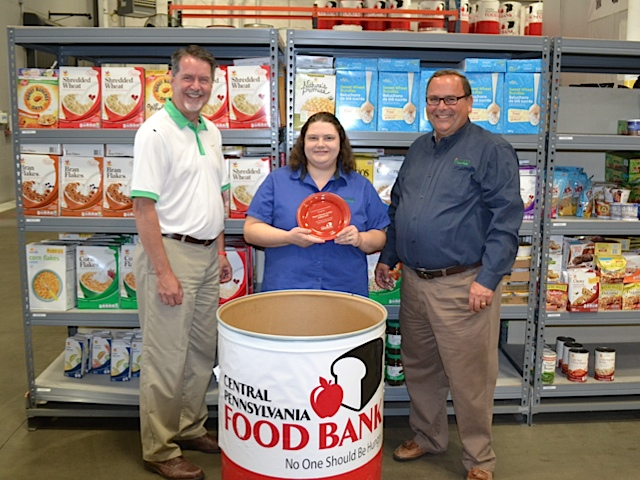 From left, Brad Peterson, director of communications and marketing, Central Pennsylvania Food Bank; Jackie Dahms, manager of Royer's in West York; and Greg Royer, president and CEO, Royer's.