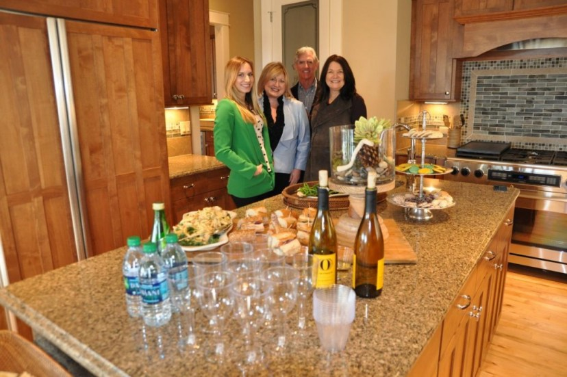 PICTURED ABOVE AND BELOW: The sales team at Vista View Estates put on a great spread of fresh foods and wine tastings befitting of living in the wine country at Mondavio.