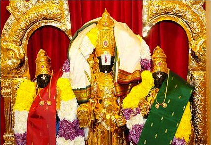 """""""Wish you looked as good as us, eh? No amount of penance will grant you that,"""" smirks Lord Balaji with Sridevi (l) and Bhudevi (r). Image Credit: http://blogs.houseofgems.com/index.php/2012/11/the-legendary-temple-jewelry-of-india/"""