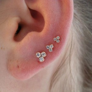 Triple earlobe piercings with fantastic jewelry