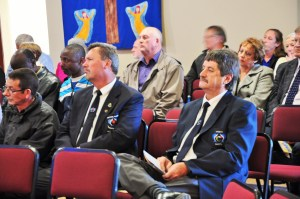Mourners attending Mr Stan Walter's funeral service in Midrand on Wednesday sit quietly while eulogies in his memory are being delivered.