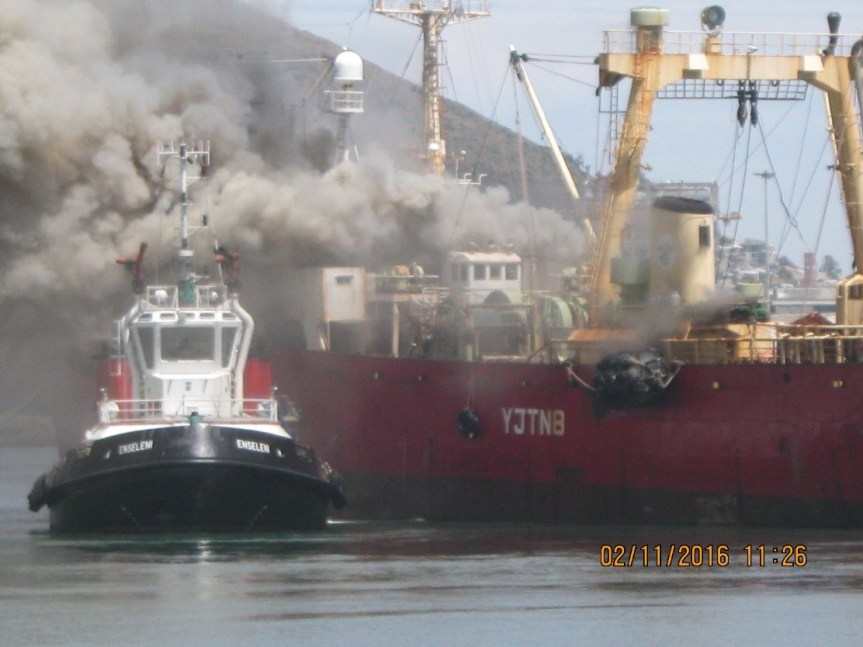 UP IN SMOKE: A Russian registered vessel on fire at the Cape Town harbour on Tuesday.