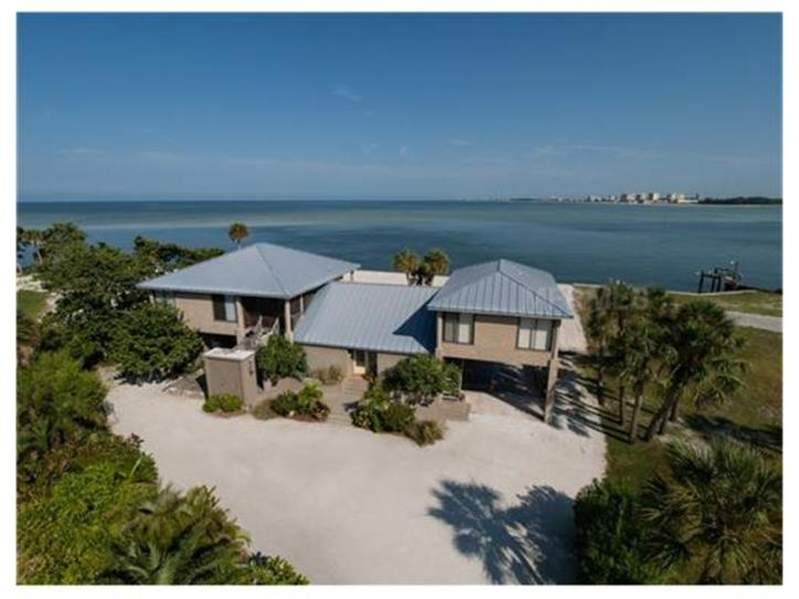 Front exterior of a Key West-style home in Siesta Key