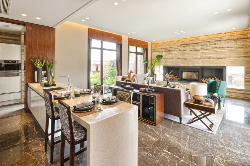 Luxurious kitchen with stone flooring and wood paneled walls.