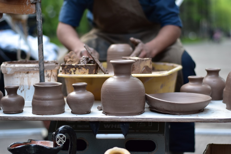 Person using pottery wheel