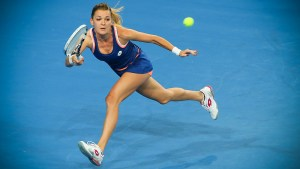PERTH, AUSTRALIA - JANUARY 02: Agnieszka Radwanska of Poland plays a forehand to Sam Stosur of Australia in the women's singles match during day six of the Hopman Cup at Perth Arena on January 2, 2014 in Perth, Australia. (Photo by Paul Kane/Getty Images)