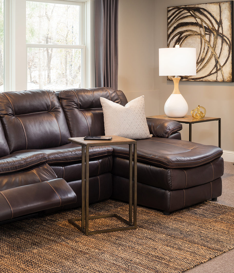 neutral space with leather small space sectional with recliner and chaise