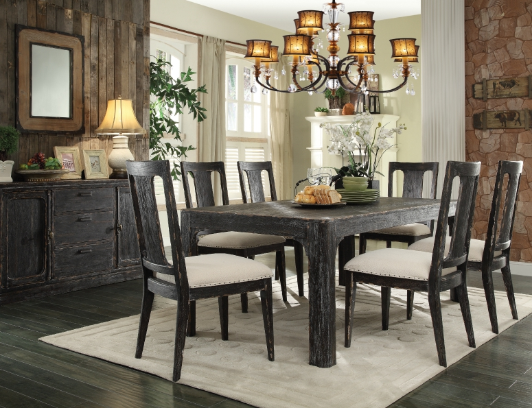 Rustic elegant dining room in black and white with reclaimed wood wall. Bellagio Dining Furniture | Schneiderman's Furniture