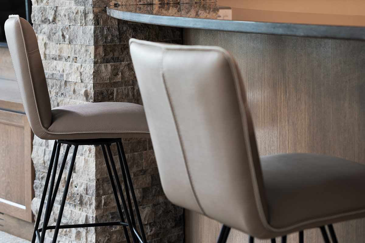 Bar Stool Height   Upholstered Bar Stool With Molded Metal Legs Sitting At  Family Room Bar