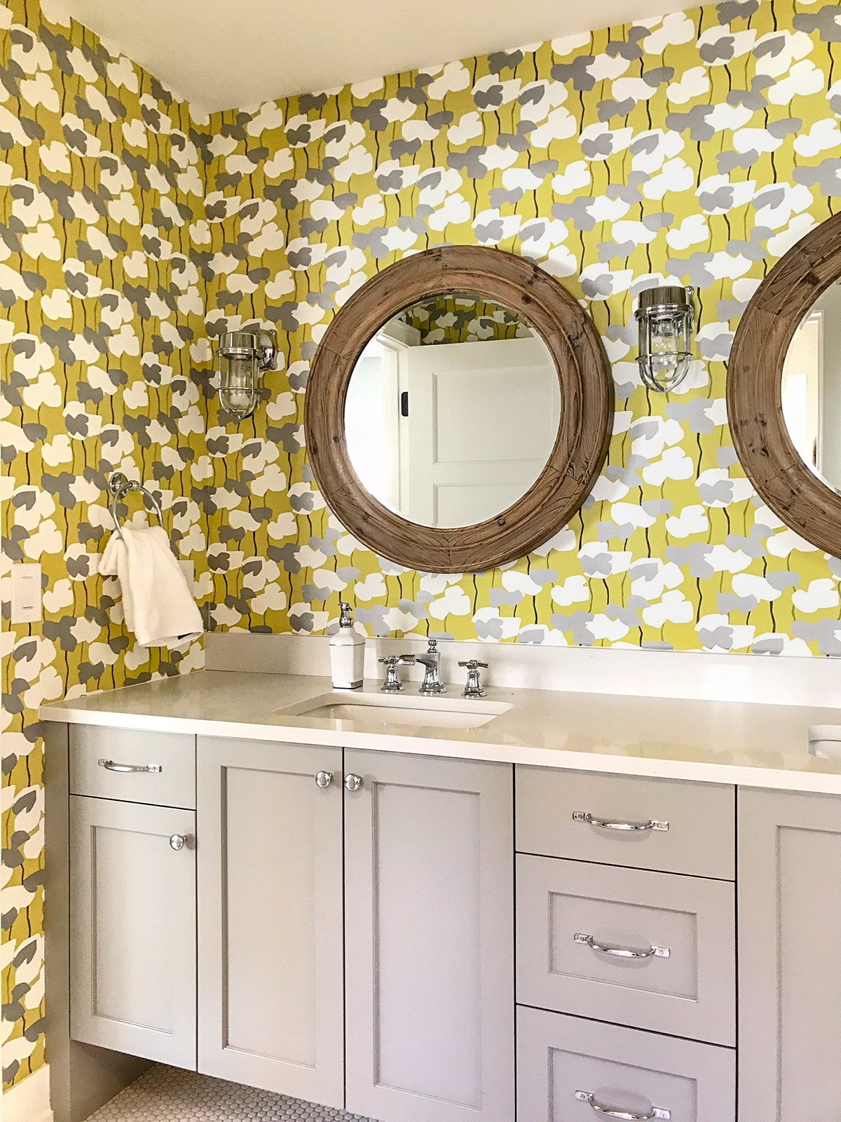 Bathroom with bold floral wallpaper and gray vanity - Bldr: Refined LLC; Designer Studio M Interiors; Photo: PK/Schneiderman's