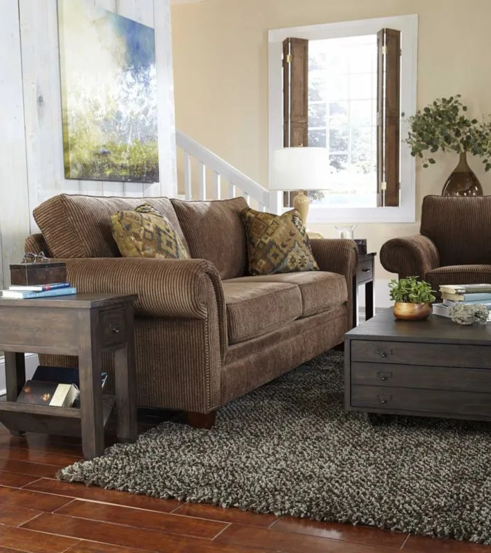 Cozy living room in brown and gray. Pretty color palette with touches of green and blue