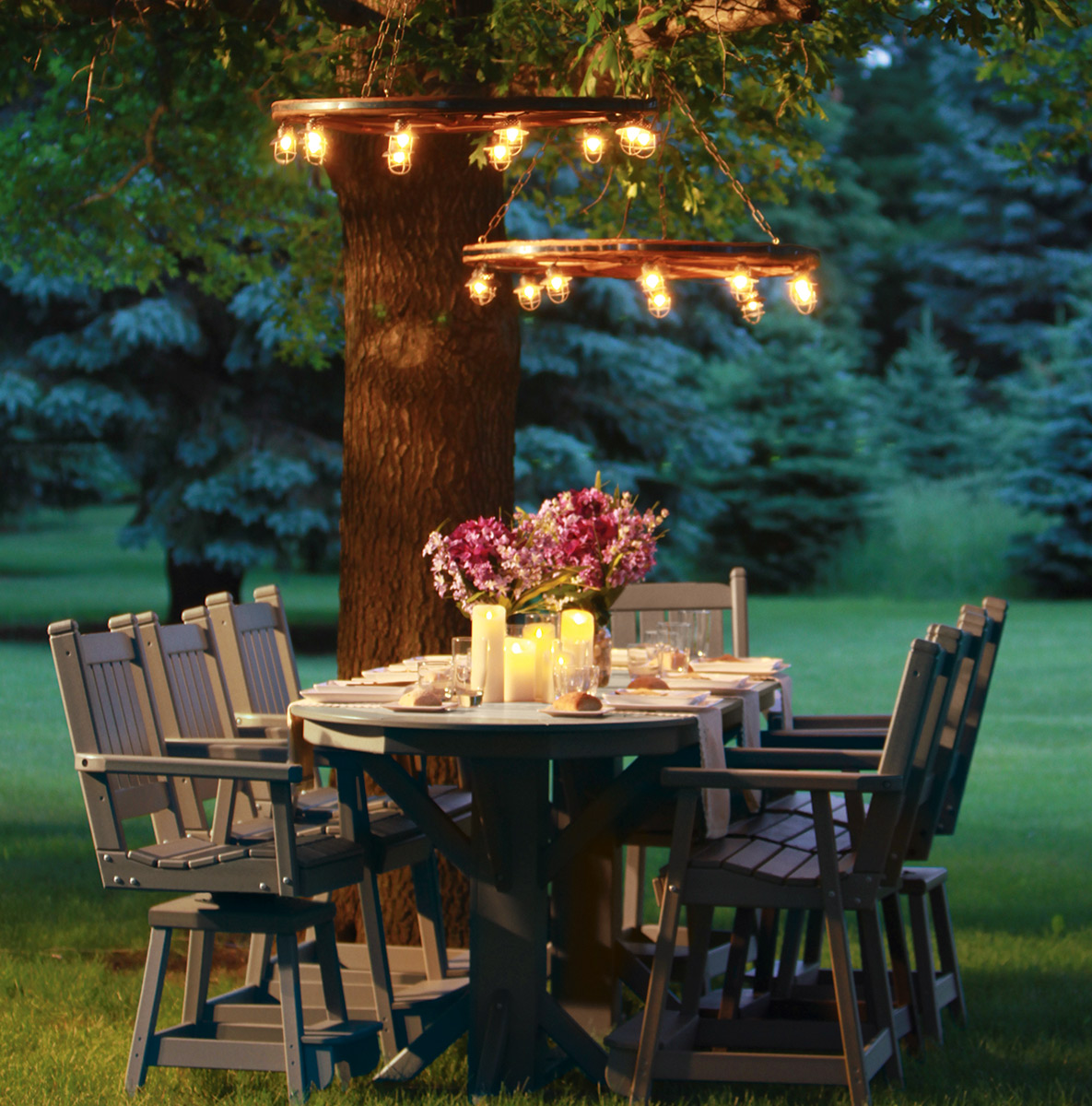 dining outdoors under the trees - lighting hung from trees