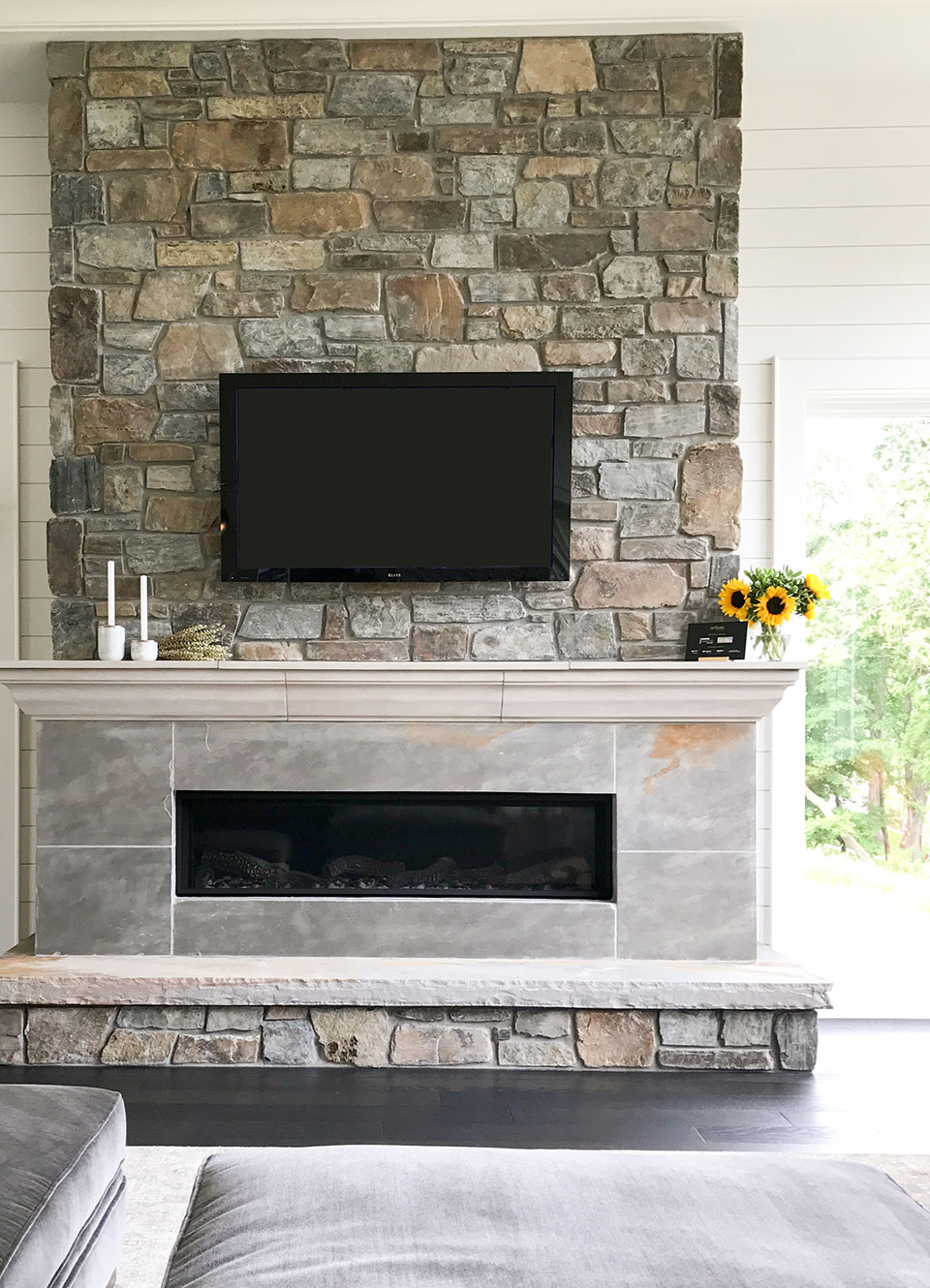 Artisan home tour - cultured stone fireplace with slate surround and hearth. Light and bright living room.