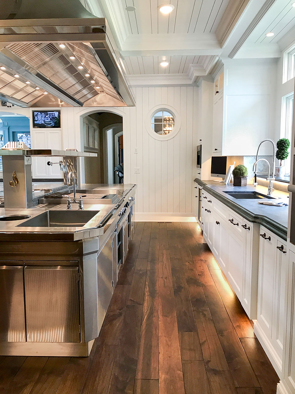 Artisan home tour large gourmet kitchen with white shiplap, custom range and hood, dark rustic hardwood floors