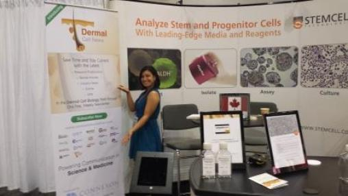 Aini promoting Connexon Creative at the 2015 World Congress of Dermatology in Vancouver. (Photo used with permission)