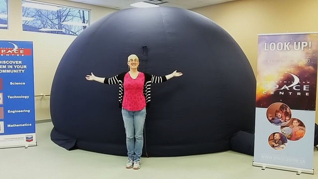 Sonya Neilson with the Starlab. Used with permission of the H.R. MacMillan Space Centre.