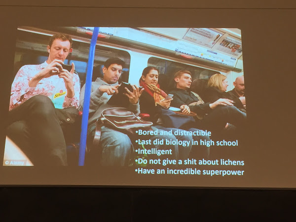 Image of people on a train looking at their phones