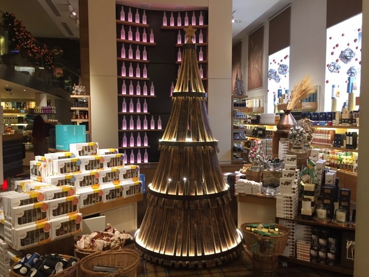 Whisky Barrel Christmas Tree surrounded by Christmas gifts