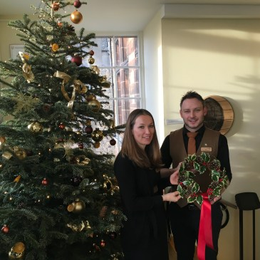 Wreath handover for charity here at Scotch Whisky Experience