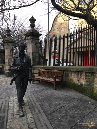 Statue of Robert Fergusson - outside Canongait Kirk