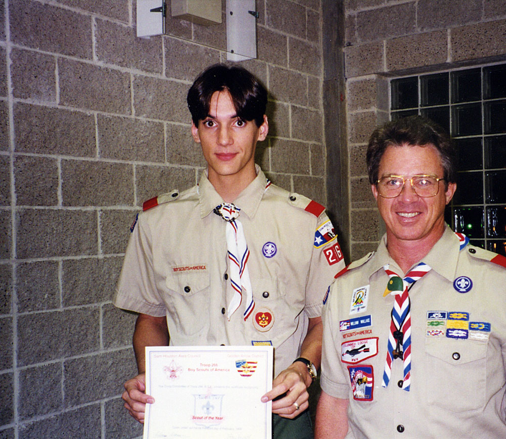 "Scoutmaster Bill Wallace presents Austin with Troop 266's ""Scout of the Year"" award."