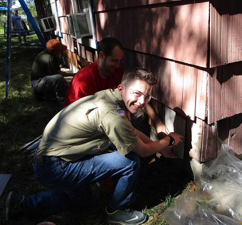 Crew leader Trevor Mangum replaces rotten shingles.
