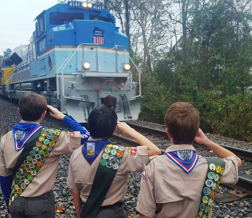 Troop 1772 Boy Scouts salute George H.W. Bush train.