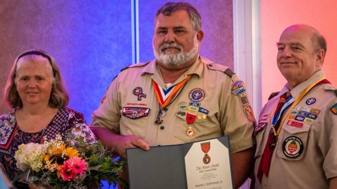 Marty Heffernan hold his award.