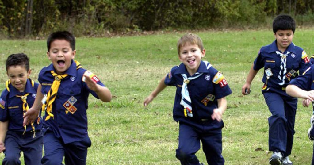 Cub Scout boys running