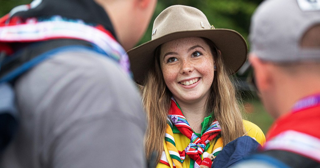 Rebecca Lake of Australia trades patches with American Scouts at the 2019 World Scout Jamboree. (Photo by Chuck Eaton)