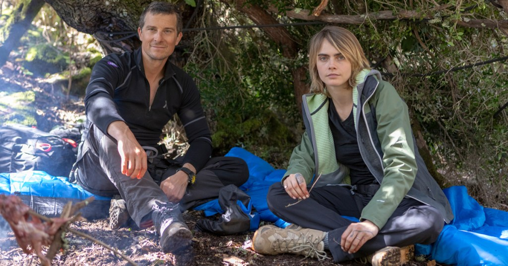 "Bear Grylls chats with actress Cara Delevingne fireside during filming of National Geographic's ""Running Wild With Bear Grylls."" (National Geographic/Jeff Ellingson)"