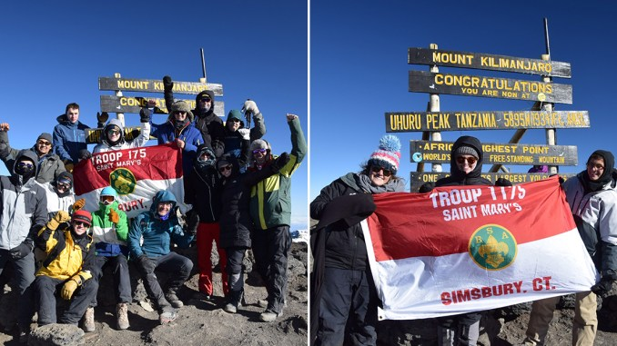 Troops hold flags on Mount Kilimanjaro
