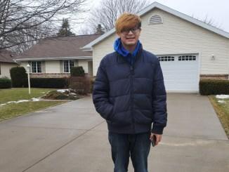 Scott Kwok in the man's driveway