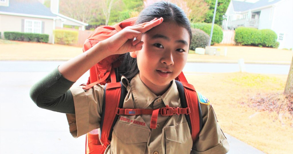 Sarah demonstrates the Scout salute.