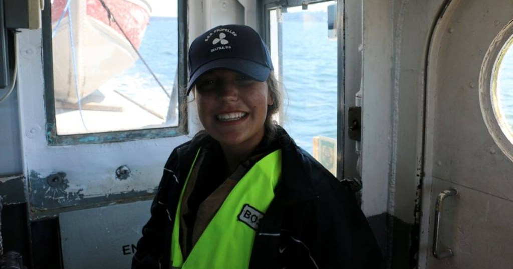 Aven Alexander smiles on a boat