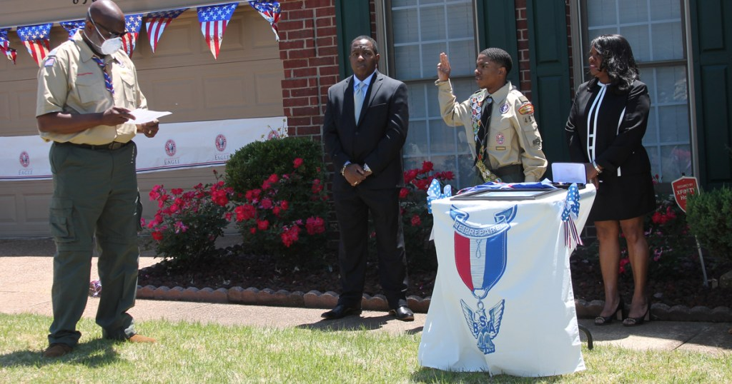 'Social distancing court of honor' held in new Eagle Scout's front yard