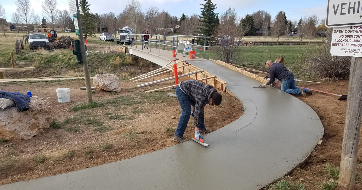 Tanner smoothing out concrete path